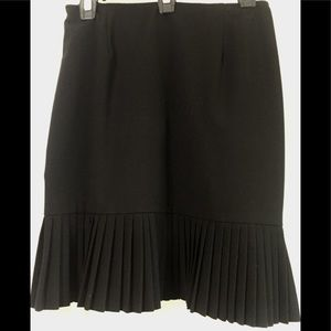 Classic black skirt with pleated bottom
